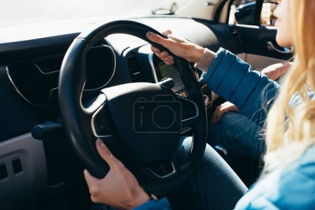 partial view of woman driving car with boyfriend near by, traveling concept