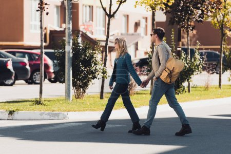 Photo for Couple holding hands while walking together in new city - Royalty Free Image