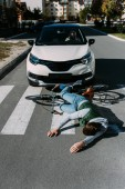 male bicycle rider hit by woman in car on road, car accident concept