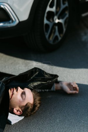high angle view of dead body on road after traffic collision
