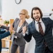 Happy insurance agents rejoicing great deal in off...