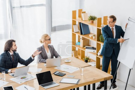 insurance workers having discussion at meeting in office