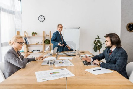 business people sitting at table during meeting in office