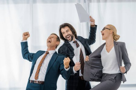 happy office workers rejoicing great deal in office