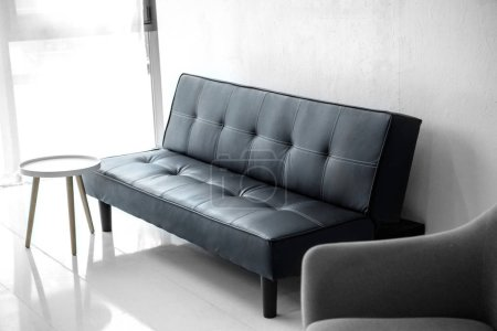 Photo for Selective focus of modern living room with leather sofa and armchair - Royalty Free Image