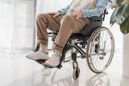 close up of senior man sitting in wheelchair in nursing home