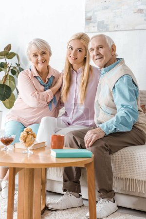 young woman spending time with senior parents