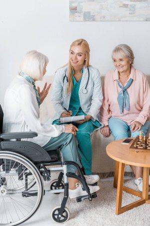 female young doctor writing prescription to senior women