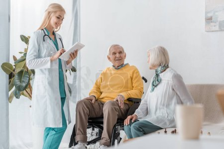 young smiling female doctor examining senior people at nursing home