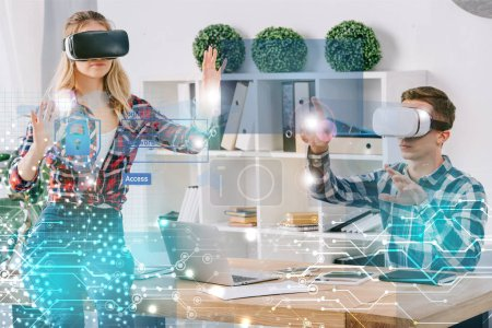 young businesspeople in virtual reality headsets gesturing at workplace in office, cyber security concept