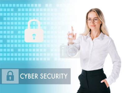 Photo for Portrait of smiling businesswoman in formal wear pointing at cyber security sign isolated on white - Royalty Free Image