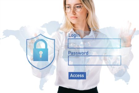 portrait of concentrated businesswoman in formal wear pointing at cyber security sign isolated on white
