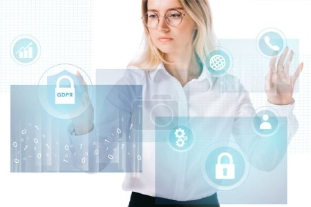 portrait of concentrated businesswoman in formal wear pointing at cyber security signs isolated on white