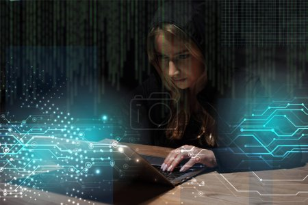 portrait of woman in black hoodie using laptop, cyber security concept