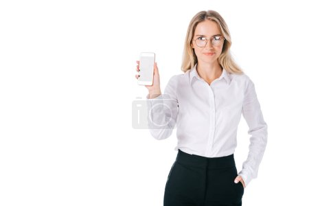 Photo for Portrait of smiling businesswoman in eyeglasses showing smartphone with blank screen isolated on white - Royalty Free Image