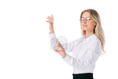 side view of businesswoman in eyeglasses gesturing isolated on white