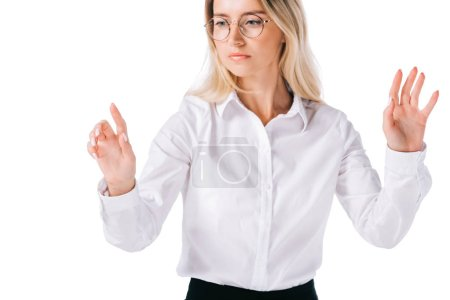 portrait of attractive businesswoman in formal wear gesturing isolated on white