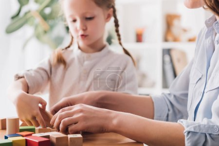 Photo for Cropped shot of mother playing blocks with adorable little child - Royalty Free Image