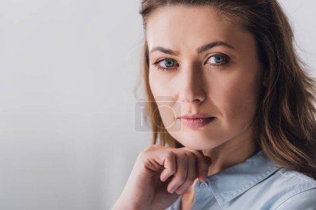 Photo for Close-up portrait of thoughtful adult woman looking at camera - Royalty Free Image