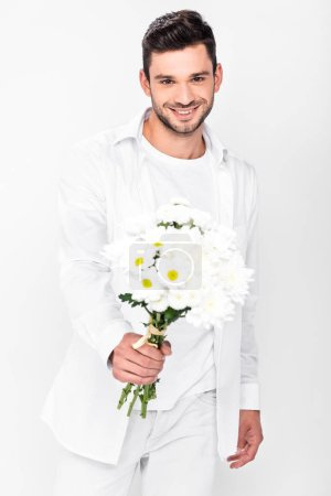 handsome smiling man in total white holding bouquet of white flowers isolated on white