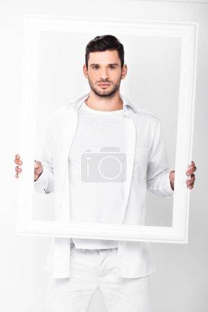Foto de Guapo hombre adulto con marco aislado en blanco - Imagen libre de derechos