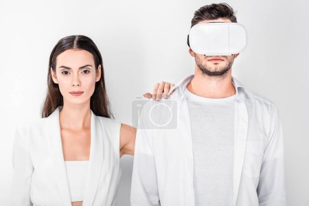 close up of woman standing with man in virtual reality headset isolated on white