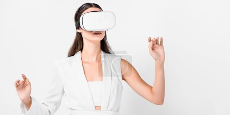 close up of adult woman gesturing in virtual reality headset isolated on white