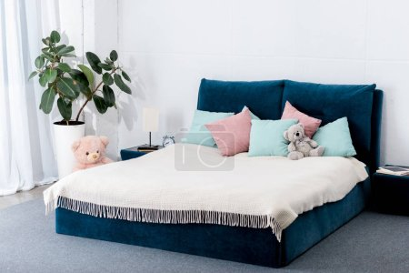 Photo for Interior view of bedroom with blue bed and toys - Royalty Free Image