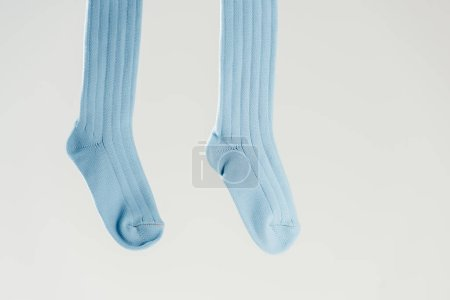 pair of blue cotton socks isolated on grey