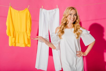 close up of beautiful woman with clothes hanging on clothesline