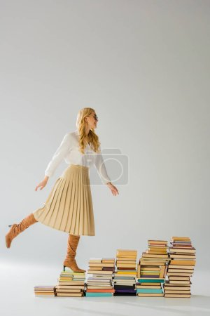 attractive adult woman posing on pile of retro books