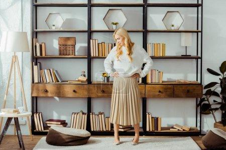 attractive blonde woman standing in loft living room