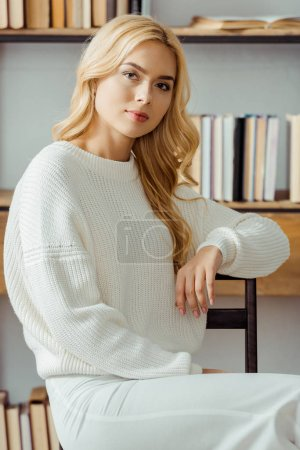 close up of beautiful woman sitting in living room