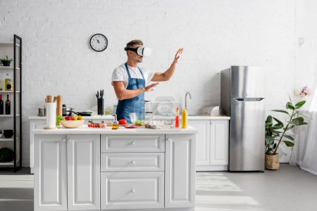 adult cooker in virtual reality headset standing at kitchen