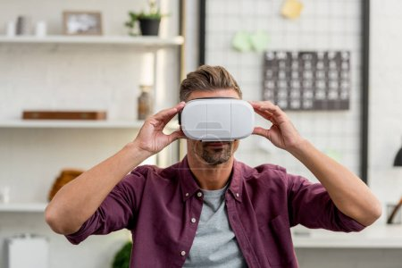 Photo for Handsome man in virtual reality headset at home office - Royalty Free Image