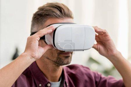 close up view of man touching virtual reality headset