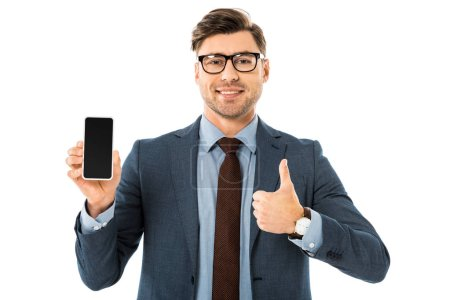 Photo for Handsome businessman in suit showing blank screen on smartphone and thumbs up isolated on white - Royalty Free Image
