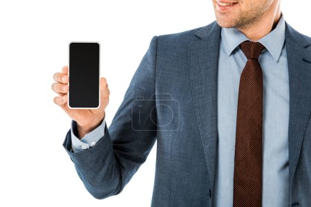close up of businessman in suit holding smartphone with blank screen isolated on white