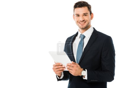 handsome smiling businessman holding digital tablet isolated on white