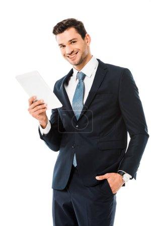 Foto de Adulto guapo empresario alegre con tableta digital aislada en blanco - Imagen libre de derechos