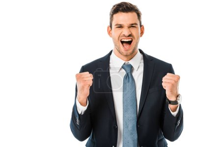 handsome pleased businessman shouting and rejoicing isolated on white