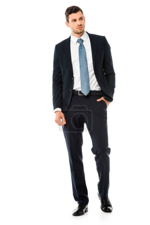 Photo for Serious handsome businessman in suit standing isolated on white - Royalty Free Image
