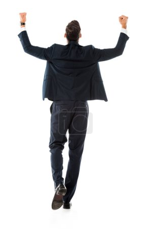 back view of businessman in suit gesturing and rejoicing isolated on white