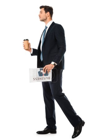 adult businessman in suit standing with business newspaper and coffee to go isolated on white