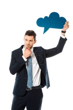 Photo pour Homme d'affaires concentrée en costume tenant bulle de pensée bleu vide isolé sur blanc - image libre de droit