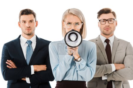 angry businesswoman shouting in megaphone while colleagues standing with arms crossed isolated on white