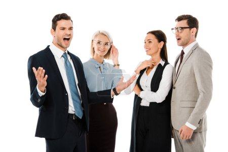 Photo pour Heureux homme d'affaires permanent avec des collaborateurs choqués isolés sur blanc - image libre de droit