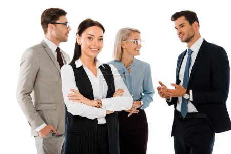 attractive successful businesswoman with crossed arms standing with professional colleagues isolated on white