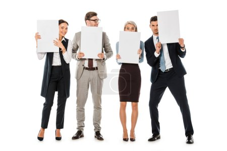 executive business team holding blank placards isolated on white