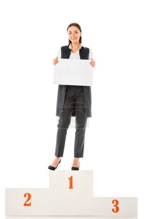 Photo for Attractive businesswoman with empty board standing on winners podium isolated on white - Royalty Free Image